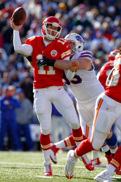 . Kansas City Chiefs quarterback Alex Smith (11) is hit by Buffalo Bills defensive tackle Kyle Williams (95) during the first quarter of an NFL football game in Orchard Park, N.Y., Sunday, Nov. 3, 2013. (AP Photo/Bill Wippert)