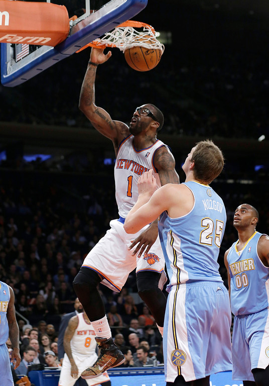 . New York Knicks\' Amare Stoudemire (1) dunks in front of Denver Nuggets\' Timofey Mozgov (25), of Russia, during the first half of an NBA basketball game Friday, Feb. 7, 2014, in New York. The Knicks won 117-90. (AP Photo/Frank Franklin II)