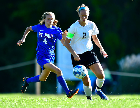 9/17/2019 Mike Orazzi | StaffrSt. Paul's Erin Downes (4) and Woodland's Olivia Kotsaftis (2) during girls soccerr in Bristol Tuesday afternoon.