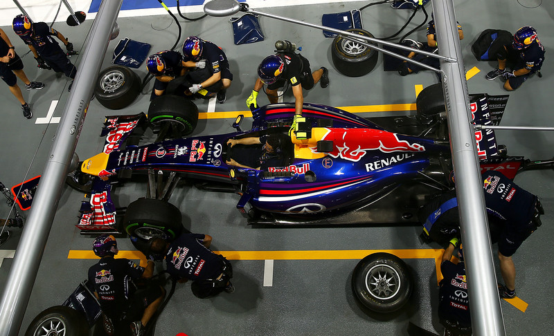 . Members of the Infiniti Red Bull Racing team take part in a pit stop practice session during previews ahead of the Singapore Formula One Grand Prix at Marina Bay Street Circuit on September 18, 2014 in Singapore, Singapore.  (Photo by Dan Istitene/Getty Images)