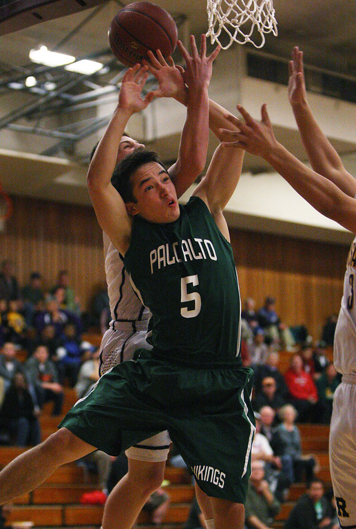 . Paly\'s Aldis Petriceks fights for a rebound against Archbishop Riordin in the first quarter at Piedmont Hills High School in San Jose, Calif. on Friday, Feb. 22, 2013.The Archbishop Riordan Crusaders played the Palo Alto Vikings in the CCS Open Division boys basketball quarterfinals. (Jim Gensheimer/Staff)