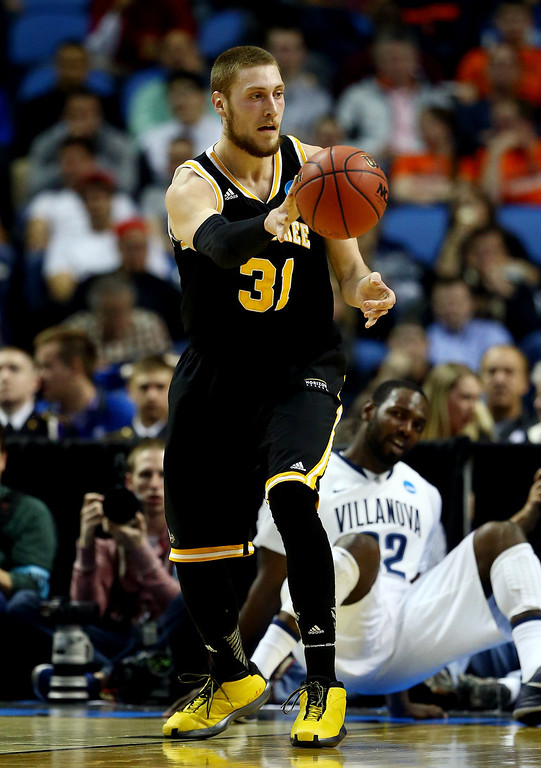 . BUFFALO, NY - MARCH 20: Matt Tiby #31 of the Milwaukee Panthers passes the ball against the Villanova Wildcats during the second round of the 2014 NCAA Men\'s Basketball Tournament at the First Niagara Center on March 20, 2014 in Buffalo, New York.  (Photo by Elsa/Getty Images)