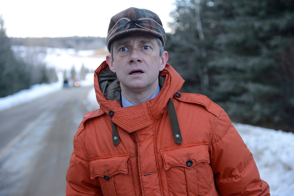 """. In this image released by FX, Martin Freeman appears in a scene from \""""Fargo.\"""" Freeman was nominated for a Golden Globe for best actor in a TV movie or mini-series for his role on Thursday, Dec. 11, 2014. The 72nd annual Golden Globe awards will air on NBC on Sunday, Jan. 11. (AP Photo/FX, Chris Large)"""