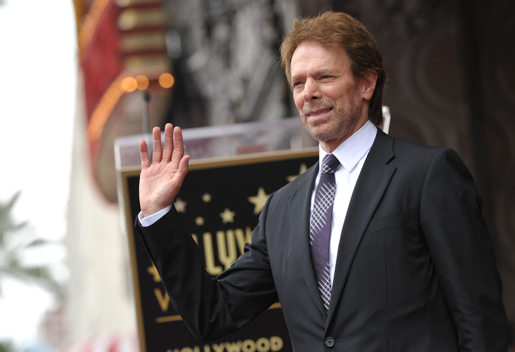 . Film producer Jerry Bruckheimer waves to the crowd at his star ceremony on the Hollywood Walk of Fame on Monday, June 24, 2013 in Los Angeles. (Photo by John Shearer/Invision/AP)