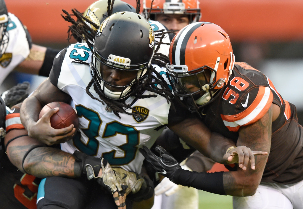 . Jacksonville Jaguars running back Chris Ivory (33) rushes against Cleveland Browns inside linebacker Christian Kirksey (58) in the second half of an NFL football game, Sunday, Nov. 19, 2017, in Cleveland. (AP Photo/David Richard)