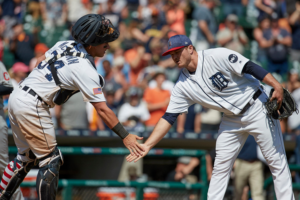 . Detroit Tigers catcher James McCann (34) and relief pitcher Justin Wilson celebrate after their 7-4 win against the Cleveland Indians in the first baseball game of a doubleheader in Detroit, Saturday, July 1, 2017. (AP Photo/Rick Osentoski)
