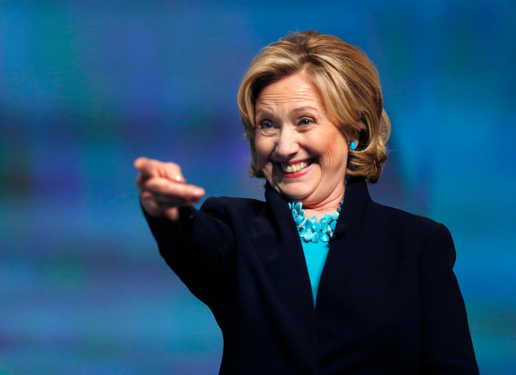 . Former Secretary of State Hillary Rodham Clinton reacts as she is introduced to speak at the Massachusetts Conference for Women in Boston, Thursday, Dec. 4, 2014. (AP Photo/Elise Amendola)