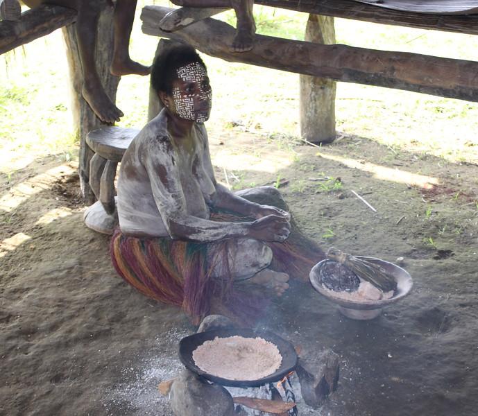 woman in Kundiman village making pancakes from Sago palm flour