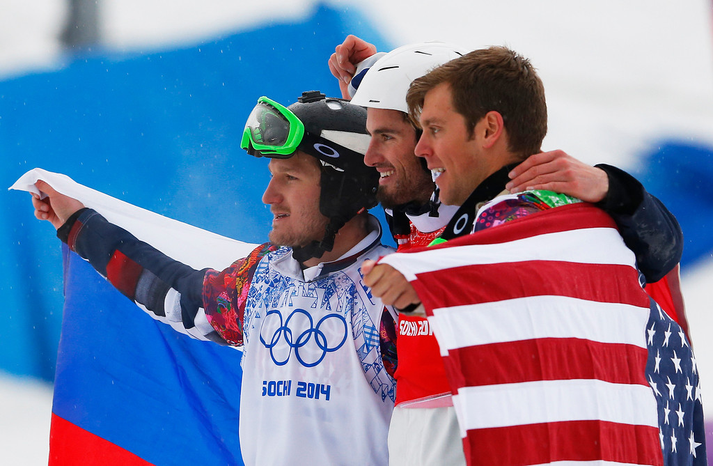 . France\'s Pierre Vaultier, center, celebrates his gold medal with silver medalist Nikolai Olyunin of Russia, left, and bronze medalist Alex Deibold, right, of the United States after the men\'s snowboard cross final at the Rosa Khutor Extreme Park, at the 2014 Winter Olympics, Tuesday, Feb. 18, 2014, in Krasnaya Polyana, Russia.(AP Photo/Sergei Grits)