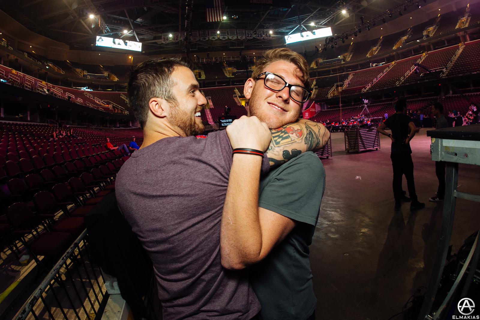 Rian Dawson of All Time Low and Thomas Falcone friendship hug before the APMAs