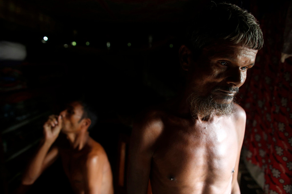 . Ainul Huq, 55, (R) and Bulbul Hossain, 25, describe the condition of their lungs inside a village house in Burimari in Lalmonirhat district, Bangladesh July 9, 2013. According to Huq and Hossain, they are sufferers of silicosis, an incurable lung disease caused by inhalation of silica dust as they used to work in a stone crushing factory. The stone crushing industry in the Burimari land port area of Lalmonirhat, in the north of Bangladesh, produces lime powder for various industrial purposes.  According to a report by the Bangladesh Institute of Labour Studies, those working in the industry run the risk of contracting silicosis. A researcher from the organization said that at least 18 workers in the Burimari area had died of complex silicosis over the last four years. International attention has been focused on workers\' safety in Bangladesh since the disaster at Rana Plaza, a garment factory complex which collapsed in April, killing 1,132 workers.   REUTERS/Andrew Biraj
