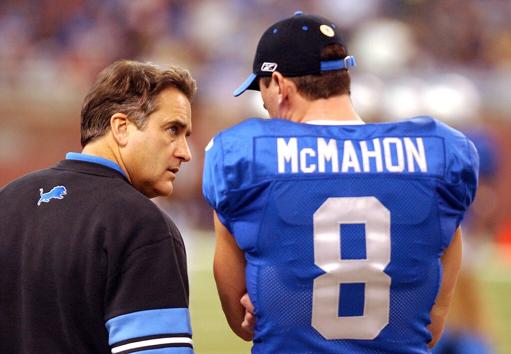 . Detroit Lions back-up QB Mike McMahon (8) chats with Lions head coach Steve Mariucci during the Thanksgiving Day game played at Ford Field in downtown Detroit.