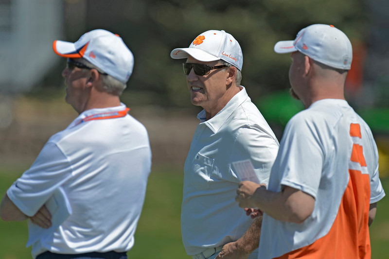. John Fox (L), John Elway, executive vice president of football operations of the Denver Broncos (C), and Matt Russell director of player personnel (R) look on during the last day of rookie mini camp May 12, 20313 at Dover Valley.   (Photo By John Leyba/The Denver Post)