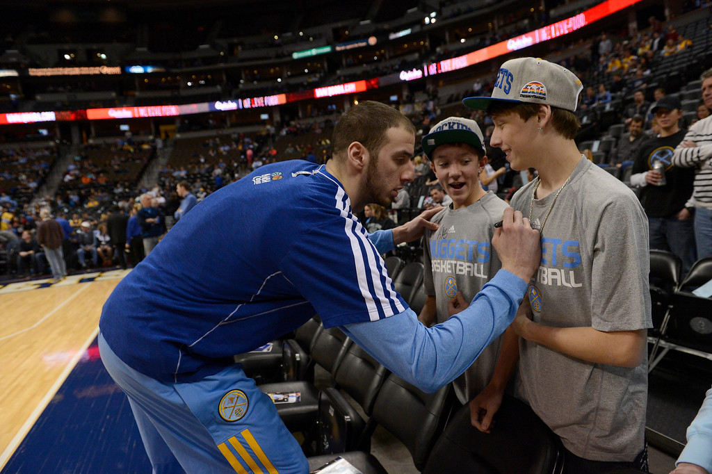 . DENVER, CO. - JANUARY 28: Denver Nuggets center Kosta Koufos (41) signs an autograph for Kyle Gholson 15-years-old (L) and  Michael Narvauz 16-years-old January 28, 2013 at Pepsi Center. The Denver Nuggets host  the Indiana Pacers in NBA Action. (Photo By John Leyba / The Denver Post)