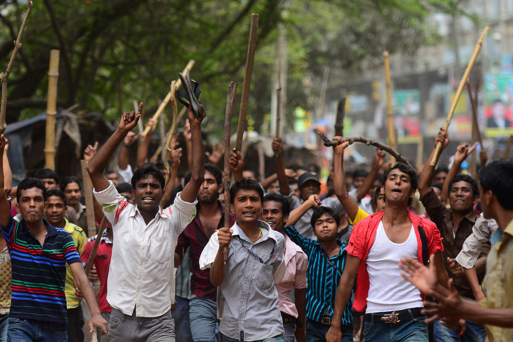 . Bangladeshi people and garments workers march in the street demanding the death sentence for owner of Rana Plaza, Sohel Rana following the eight-story building collapse in Savar, on the outskirts of Dhaka, on April 30, 2013.  AFP PHOTO/MUNIR UZ ZAMAN/AFP/Getty Images