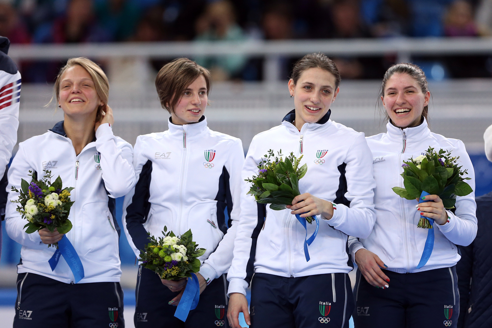 . Bronze medalist Italy celebrate on the podium during the flower ceremony for the Short Track Ladies\' 3000m Relay at Iceberg Skating Palace on day 11 of the 2014 Sochi Winter Olympics on February 18, 2014 in Sochi, Russia.  (Photo by Matthew Stockman/Getty Images)