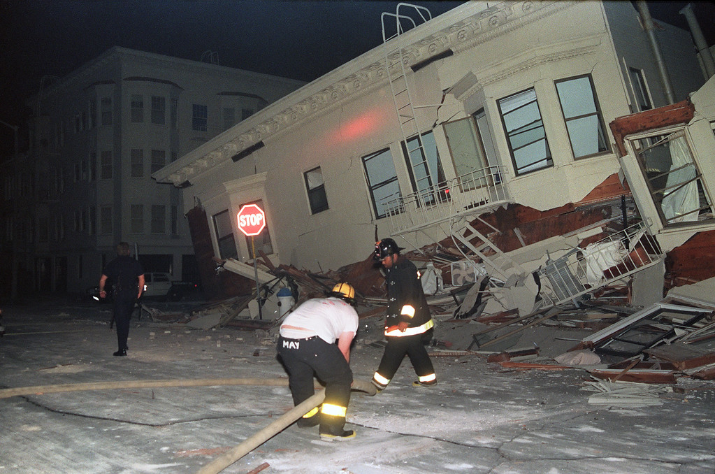 . Firemen search for occupants in a heavily-damaged building in the Marina District of San Francisco, one of the areas hardest hit in the city by a 6.9 earthquake  on October 17, 1989. (CHRIS WILKINS/AFP/Getty Images)