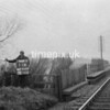 NJ920911A, Man marking Ordnance Survey minor control revision point with an arrow in 1950s