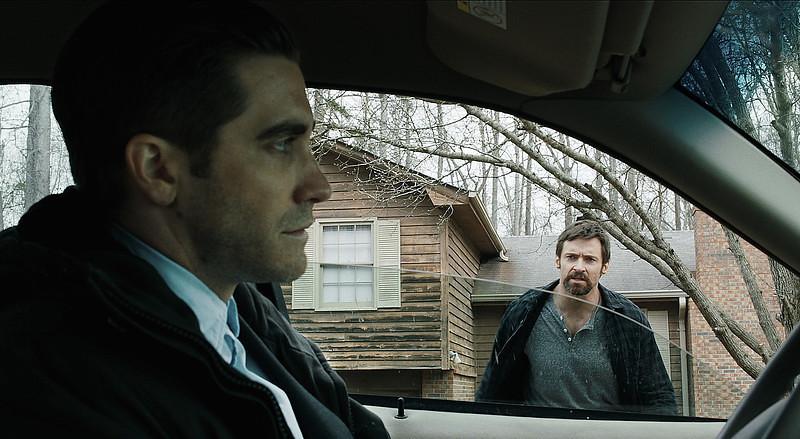 . Jake Gyllenhaal as Detective Loki and Hugh Jackman as Keller Dover in \'Prisoners.\' (Warner Bros. Pictures)