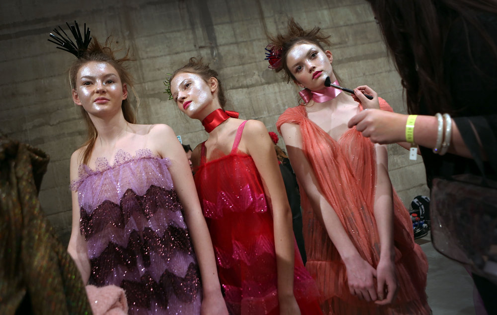 Description of . Models backstage at the Fashion East show during London Fashion Week Fall/Winter 2013/14 at TopShop Show Space on February 18, 2013 in London, England.  (Photo by Tim Whitby/Getty Images)