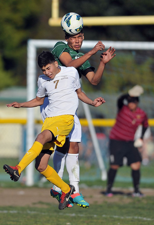 . 2/13/13 - Jorge Rojas of Kennedy High School battles for the ball against  Angel Hernandez of Narbonne during the L.A. City Section Division I playoffs. Narbonne won 1-0. Photo by Brittany Murray / Staff Photographer