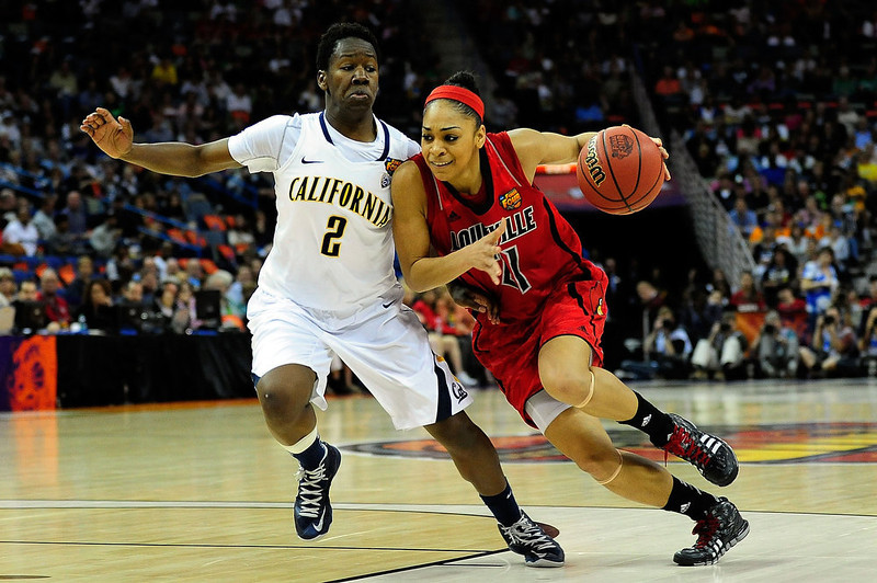 . Afure Jemerigbe #2 of the California Golden Bears defends as Bria Smith #21 of the Louisville Cardinals drives to the basket during the National Semifinal game of the 2013 NCAA Division I Women\'s Basketball Championship at New Orleans Arena on April 7, 2013 in New Orleans, Louisiana. (Photo by Stacy Revere/Getty Images)