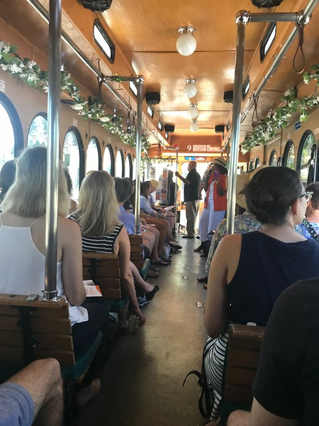 Vickie Oldham, in the straw hat, breaks down Newtown's history for a trolley-full of New College students.