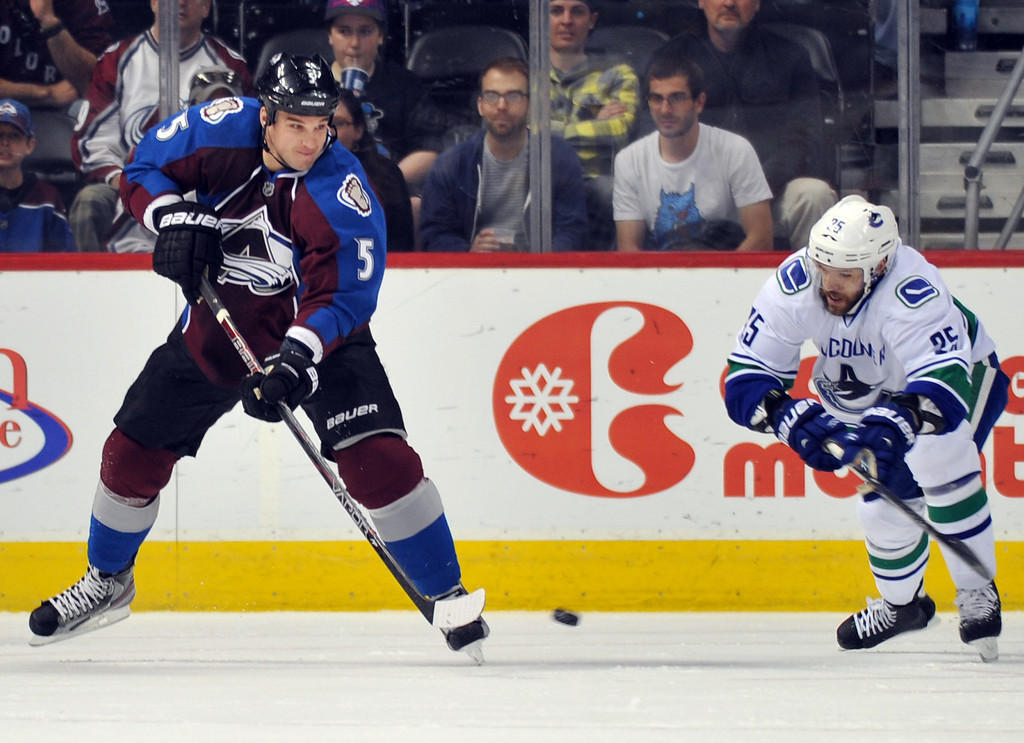 . DENVER, CO. - APRIL 13 : Shane O\'Brien of Colorado Avalanche (5) controls the puck against Andrew Ebbett of Vancouver Canucks in the 1st period of the game at Pepsi Center. Denver, Colorado. April 13, 2013. Colorado won 4-3. (Photo By Hyoung Chang/The Denver Post)