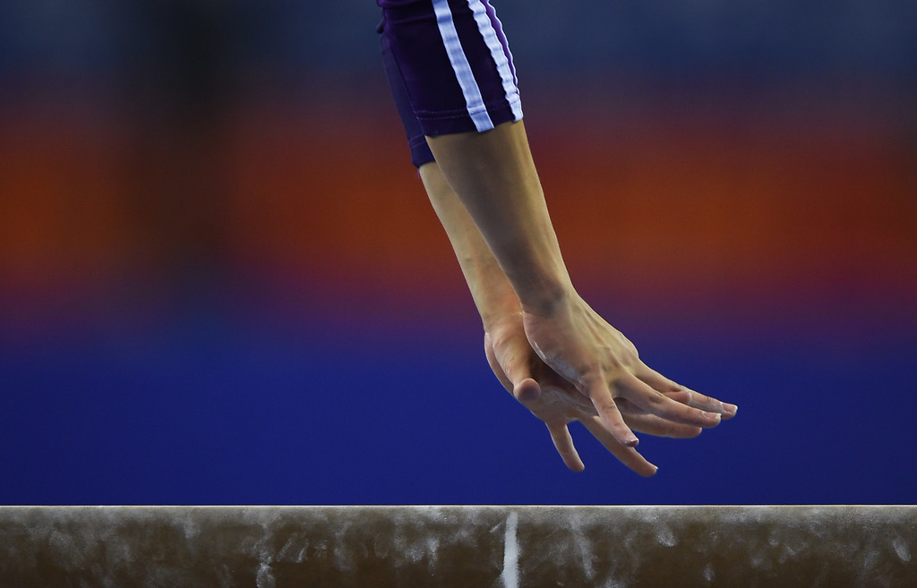 . Brazil\'s Mariana de Oliveira performs on the beam during the women\'s qualification at the Gymnastics World Championships in Nanning, in China\'s southern Guangxi province on October 5, 2014.GREG BAKER/AFP/Getty Images