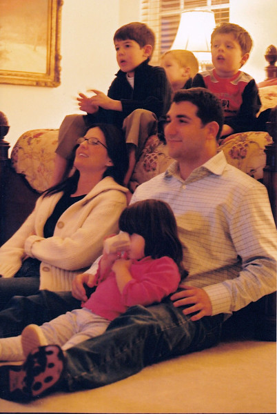 "Watching a movie at Thanksgiving: on bed: Josh Berenzweig, Adam Berenzweig, Noah Friedlander. On floor: Heather & Stuart Kafetz, and Leah Rothman (Stuart's niece). November 2003.  Scanned from 4x6"" print in 2019."