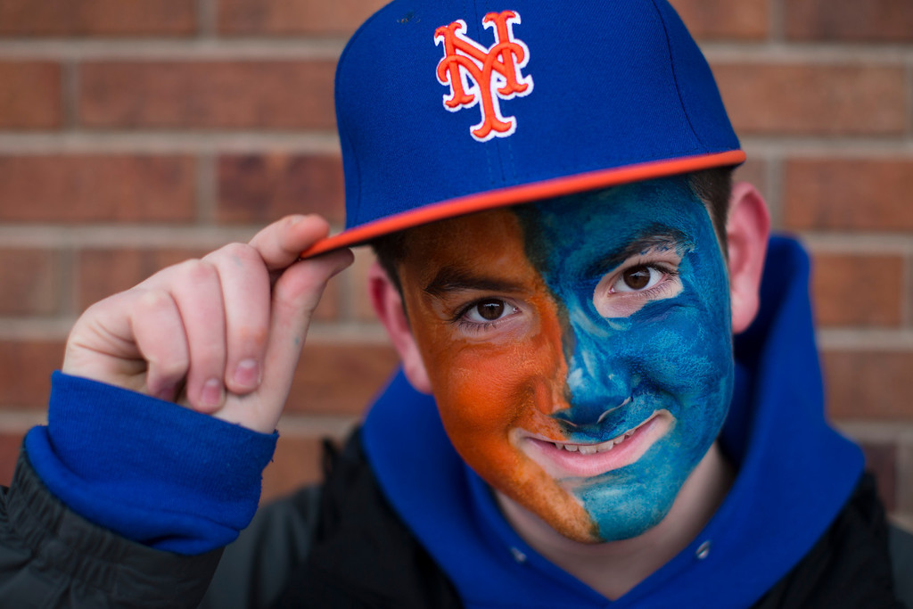 . David Schneider, of Oceanside, N.Y., shows off his face paint outside Citi Field before on opening day baseball game between the Washington Nationals and the New York Mets, Monday, March 31, 2014, in New York. (AP Photo/John Minchillo)
