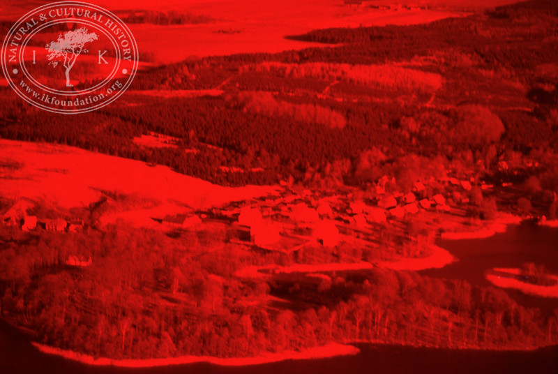 Experimental photography with red filter over landscapes with plantations, agriculture, water and settlements around Vombsjön (9 May, 1986). | LH.0221