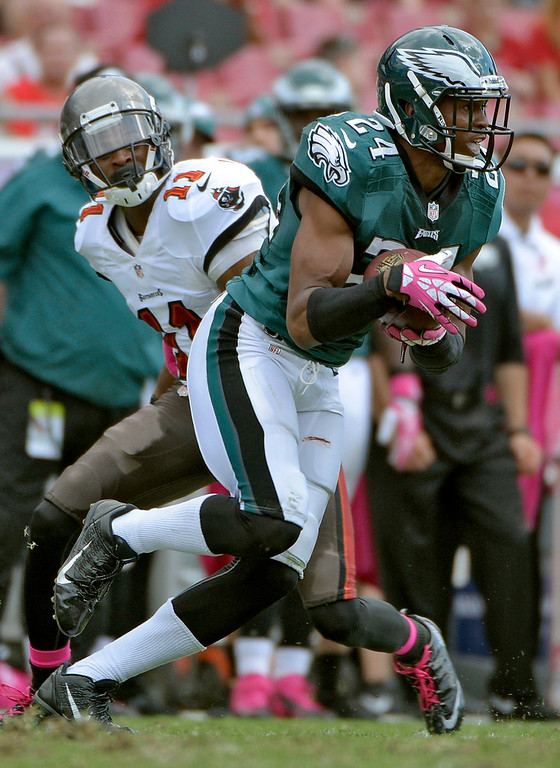 . Philadelphia Eagles cornerback Bradley Fletcher (24) intercepts a pass intended for Tampa Bay Buccaneers wide receiver Tiquan Underwood (11) during the third quarter of an NFL football game Sunday, Oct. 13, 2013, in Tampa, Fla. (AP Photo/Phelan M. Ebenhack)