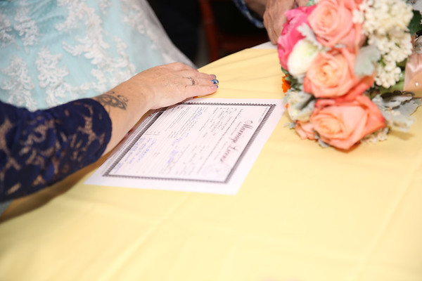 Reception: sign marriage license