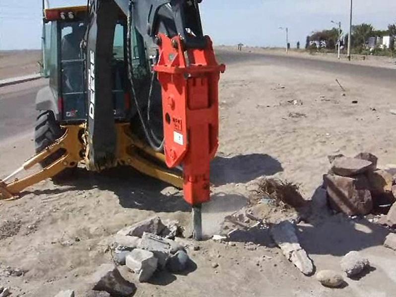 NPK GH3 hydraulic hammer on Deere backhoe.jpg
