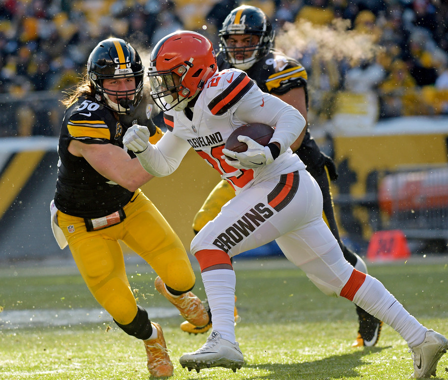 . Cleveland Browns running back Duke Johnson (29) carries the ball with Pittsburgh Steelers outside linebacker Anthony Chickillo (56) defending during the first half of an NFL football game in Pittsburgh, Sunday, Dec. 31, 2017. (AP Photo/Don Wright)