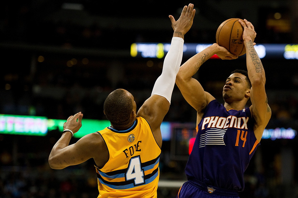 . DENVER, CO - DECEMBER 20: Gerald Green #14 of the Phoenix Suns goes up for a shot against Randy Foye #4 during the fourth quarter of an NBA game at the the Pepsi Center on December 20, 2013, in Denver, Colorado. The Suns won 103-99. (Photo by Daniel Petty/The Denver Post)