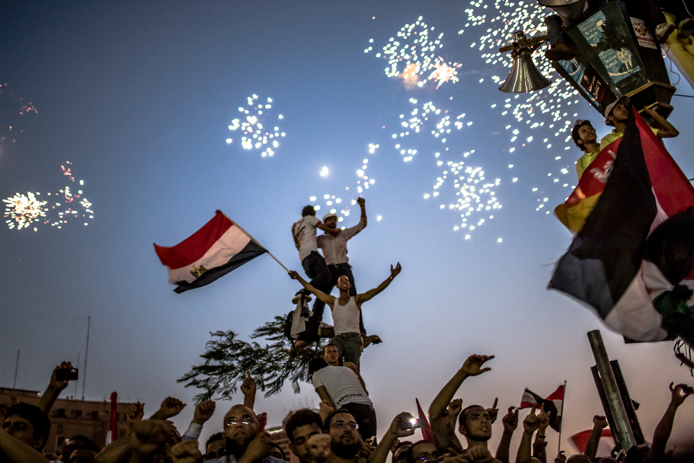 Description of . Egyptians celebrate the election of their new president Mohamad Morsi in Tahrir Square on June 24, 2012 in Cairo, Egypt. Official election results today confirmed that Mohamed Morsi is to be the next president of Egypt. Morsi received over 13 million or 51.7% of the votes, while his main rival, former Prime Minister Ahmed Shafiq, received 48.27 percent. (Photo by Daniel Berehulak/Getty Images)