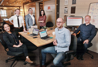 Tech startup Transpose staff are pictured in their offices at The Makers Space in Seattle, Wash