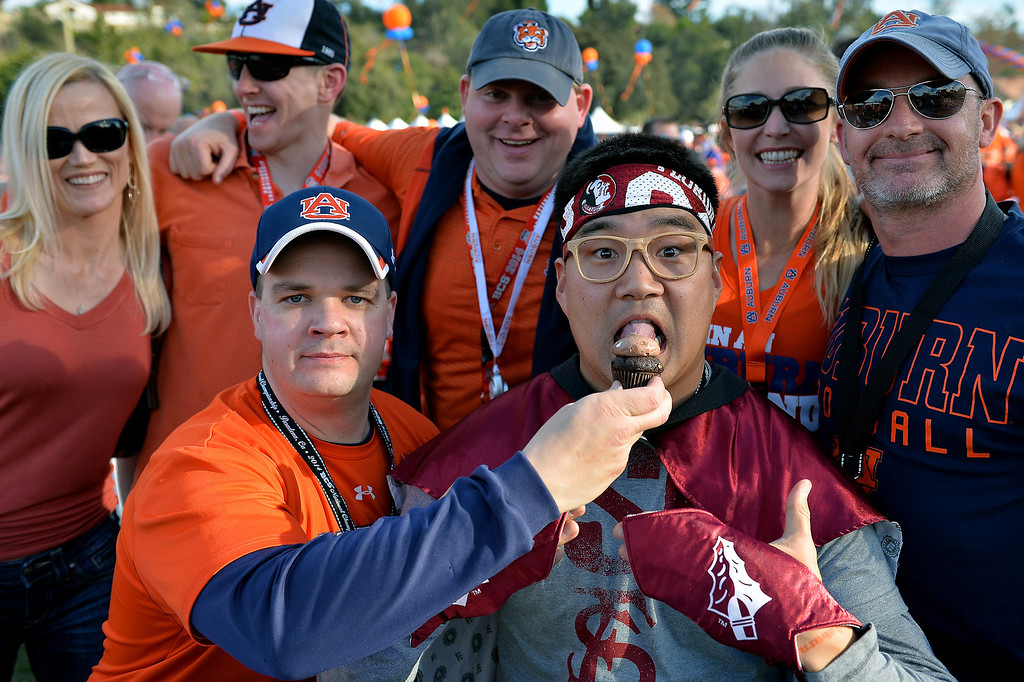 . Auburn fans have fun with a Florida State friend before the BCS game at the Rose Bowl, Monday, January 6, 2014. (Photo by Michael Owen Baker/L.A. Daily News)