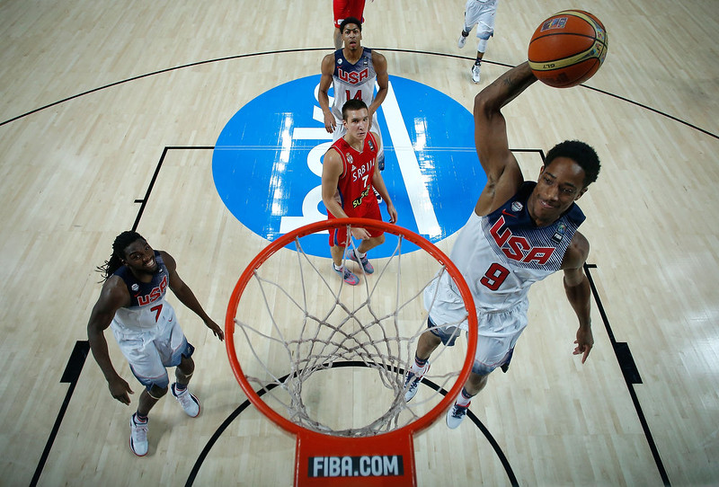 . Demar Derozan (R) of the USA shoots close to his teammate Kenneth Faried (L) as Bogdan Bognadgovic (2ndL) of Serbia looks them during the 2014 FIBA World Basketball Championship final match between USA and Serbia at Palacio de los Deportes on September 14, 2014 in Madrid, Spain. (Photo by Gonzalo Arroyo Moreno/Getty Images)
