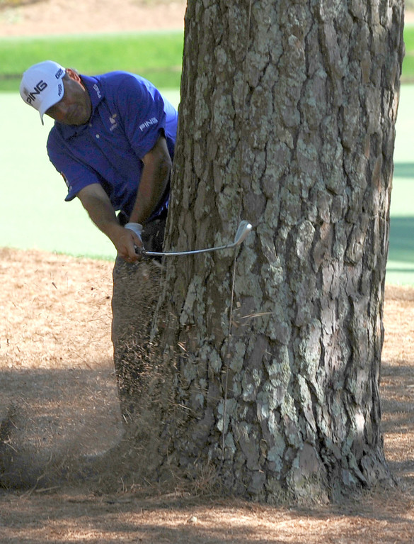 . Angel Cabrera of Argentina hits a shot from behind a tree during the third round of the 77th Masters golf tournament at Augusta National Golf Club on April 13, 2013 in Augusta, Georgia.  DON EMMERT/AFP/Getty Images