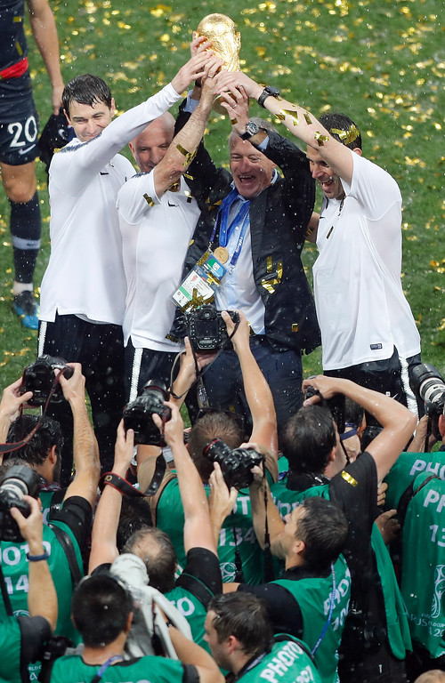 . France head coach Didier Deschamps, second right, celebrates after his team won the final match between France and Croatia at the 2018 soccer World Cup in the Luzhniki Stadium in Moscow, Russia, Sunday, July 15, 2018. (AP Photo/Frank Augstein)