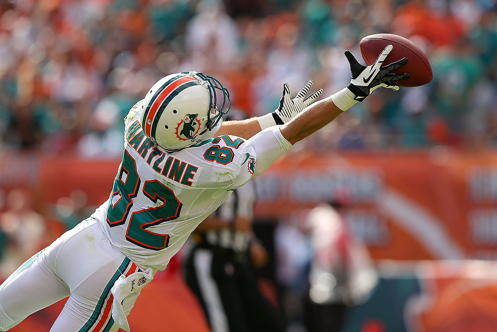 Description of . Brian Hartline #82 of the Miami Dolphins misses a pass during a game against the New England Patriots at Sun Life Stadium on December 2, 2012 in Miami Gardens, Florida.  (Photo by Mike Ehrmann/Getty Images)