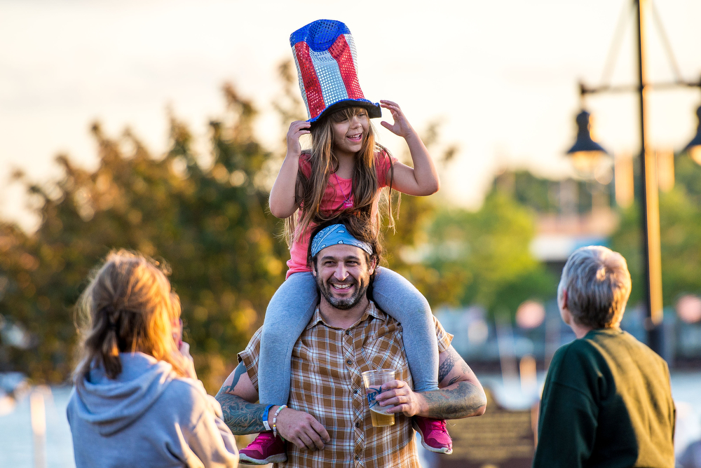 Description of . Eduardo Cotto, holds his daughter Sophia Cotto, 6, on his shoulders while listening to the musical sounds of Terry Lee Goffee, from The