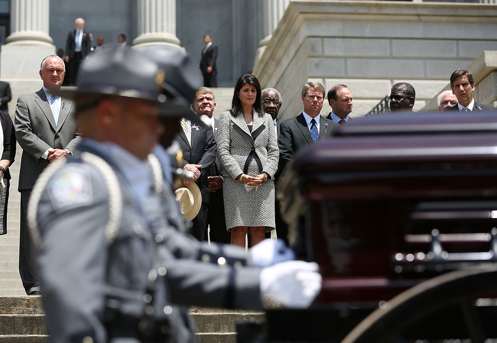 . South Carolina Governor Nikki Haley looks on as she stands with other lawmakers as South Carolina Highway Patrol Honor Guard prepare to carry the coffin of church pastor and South Carolina State Sen. Clementa Pinckney to lie in repose at the Statehouse Rotunda on June 24, 2015 in Columbia, South Carolina. Pinckney was one of nine people killed during a Bible study inside Emanuel AME church in Charleston. U.S. President Barack Obama and Vice President Joe Biden are expected to attend the funeral which is set for Friday June 26 at the TD Arena.  (Photo by Joe Raedle/Getty Images)