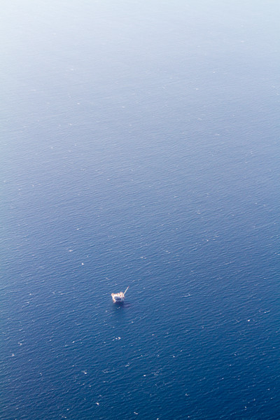 Aerial view of oil rig at sea