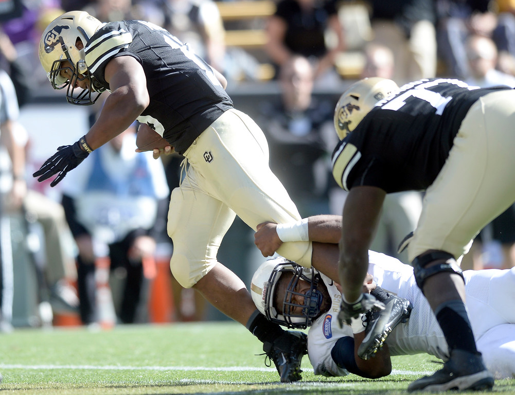 . University of Colorado\'s Michael Adkins II runs in for a touchdown over Aaron Brown during a game against Charleston Southern on Saturday, Oct. 19, at Folsom Field in Boulder.  (Jeremy Papasso/Boulder Daily Camera)