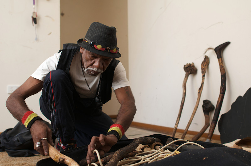 Aboriginal Elder Artist Packing his Equipment