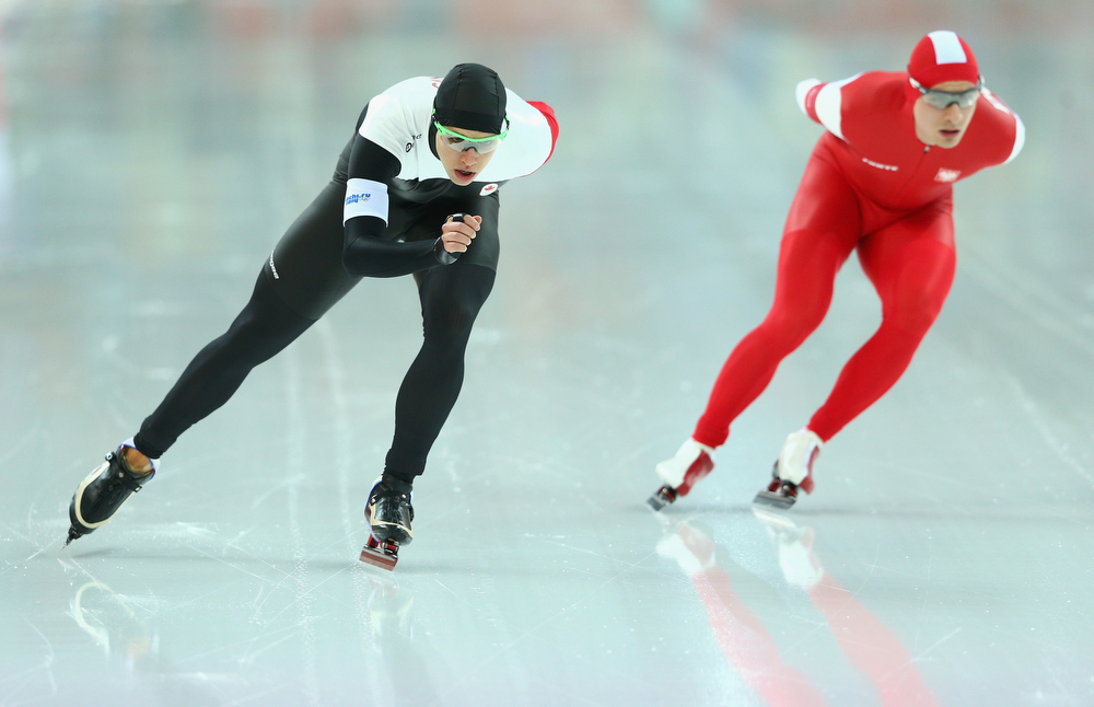 . Mathieu Giroux (L)of Canada and Jan Szymanski of Poland compete during the Men\'s 5000m Speed Skating event during day 1 of the Sochi 2014 Winter Olympics at Adler Arena Skating Center on February 8, 2014 in Sochi, Russia.  (Photo by Paul Gilham/Getty Images)